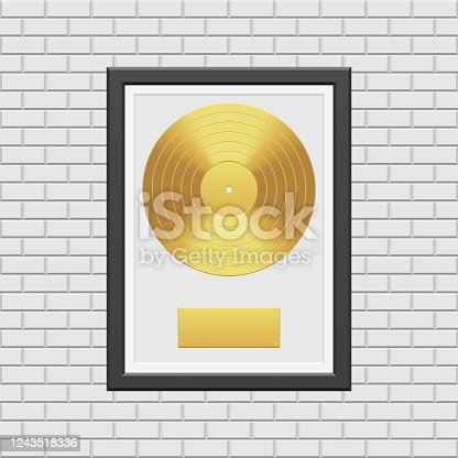 istock Gold vinyl record with black frame on white brick wall 1243518336