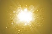 defocussed lightburst on golden background