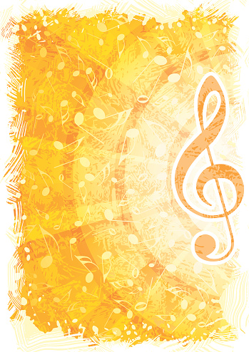 Golden abstract music background with focus on treble clef