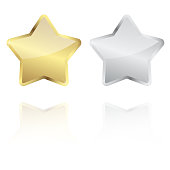 golden and silver star with reflection