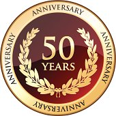 Golden anniversary shield celebrating fifty years.
