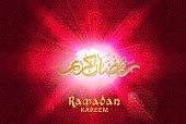 Vector illustration of Golden Arabic Islamic calligraphy text Ramadan Kareem on glowing red background