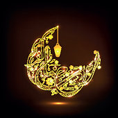 Golden Arabic text with lantern for Ramadan Kareem.