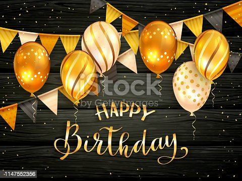 Golden Birthday Balloons and Pennants on Black Wooden Background