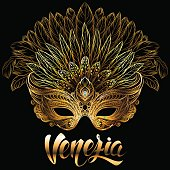 Golden carnival mask with feathers. Venetian carnival. Concept design with hand drawn lettering for t-shirt print, poster, greeting card, party invitation, banner or flyer.