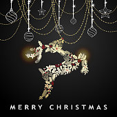 Celebrate the Christmas and New Year with shiny ornaments and Christmas floral forming a reindeer shape on the black background