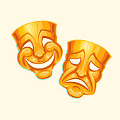 Golden comic and tragic theater mask