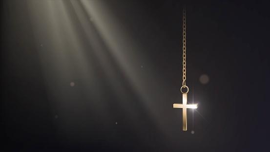 Golden cross in the sun rays