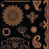 A collection of golden design elements such as a elephants, lotus flower, mandala and paisley. (Includes .jpg)