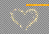 istock Golden heart of glitter light effect. 1165363644