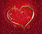 Gold, jewelry heart on a red velvety background. Valentine's Day.