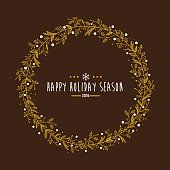 Golden holiday wreath with holiday wishes