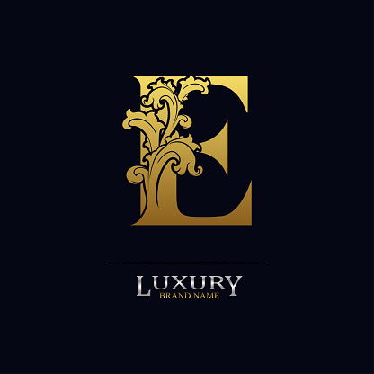 Golden initial letter E with floral leaves. Luxury Natural Logo Icon. Elegant botanic design. Modern alphabet with branch ornament for monogram, emblem, initial, label, brand, business, greeting card