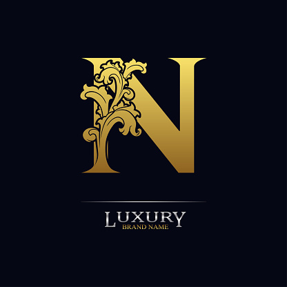 Golden initial letter N with floral leaves. Luxury Natural Logo Icon. Elegant botanic design. Modern alphabet with branch ornament for monogram, emblem, initial, label, brand, business, greeting card
