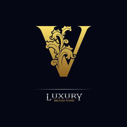 Golden initial letter V with floral leaves. Luxury Natural Logo Icon. Elegant botanic design. Modern alphabet with branch ornament for monogram, emblem, initial, label, brand, business, greeting card