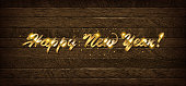 Golden inscription Happy New Year 2019 on wooden background. Vector illustration