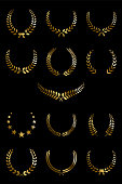 Golden laurel wreaths isolated on black background. Vector design elements.
