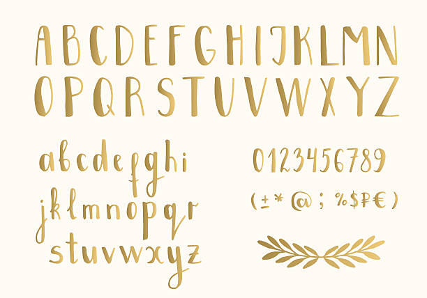 Golden letters Golden letters. Hand drawn latin font. Vector. Isolated. alphabet drawings stock illustrations