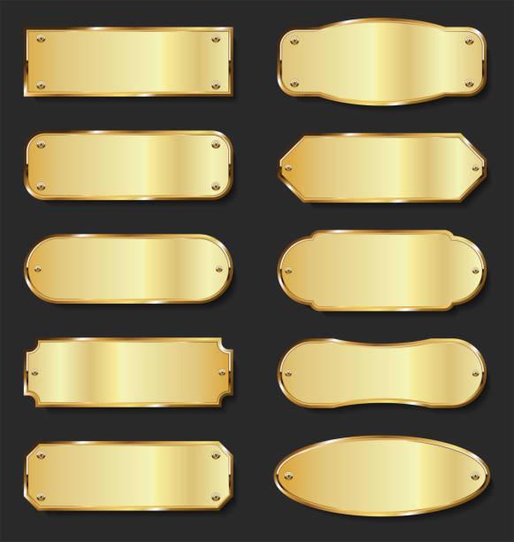 kolekcja złotych płyt metalowych na czarnym tle - metal stock illustrations
