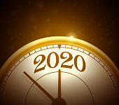 Gold 2020 clock or time symbol.