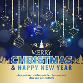 Celebrate the Christmas and New Year with shiny gold colored ornaments and elements on the blue background