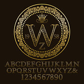Golden ornate letters and numbers with W initial monogram. Decorative patterned font for design. Isolated english vintage alphabet, figures.
