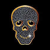 Golden skull with jewels and diamonds as a pendant and an ornament. The magical Golden skull.