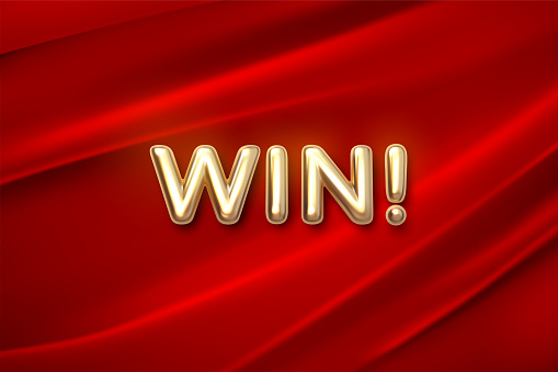 Golden WIN sign on red fabric background.