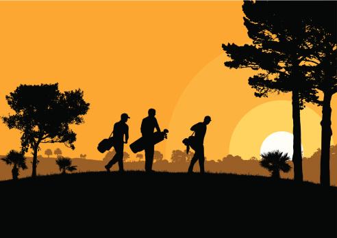 Golfers at dusk
