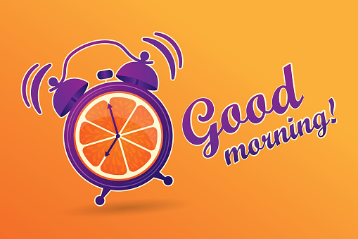 Good morning. Energetic, vitamin morning. The alarm clock is ringing. Cheerfulness in the morning. Alarm clock with oranges. Wake up, time for Breakfast. Blank space for your content, template.