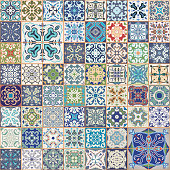 Gorgeous floral patchwork design. Colorful square tiles ornaments. seamless background.