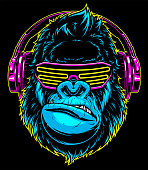 istock Gorilla with headphones 1160408165