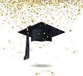 graduate cap and confetti