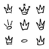 Graffiti crown set in black over white. Drawn by marker. Vector illustration.