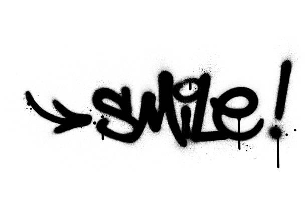 graffiti smile word sprayed in black over white graffiti smile word sprayed in black over white vandalism stock illustrations
