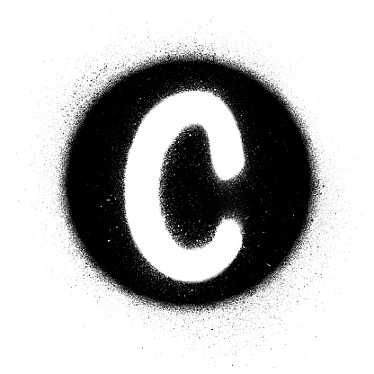graffiti white C font sprayed in black circle