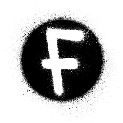 graffiti white F font sprayed in black circle