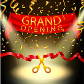 Grand opening background with spotlight and gold confetti