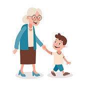 Grandmother and grandson walking