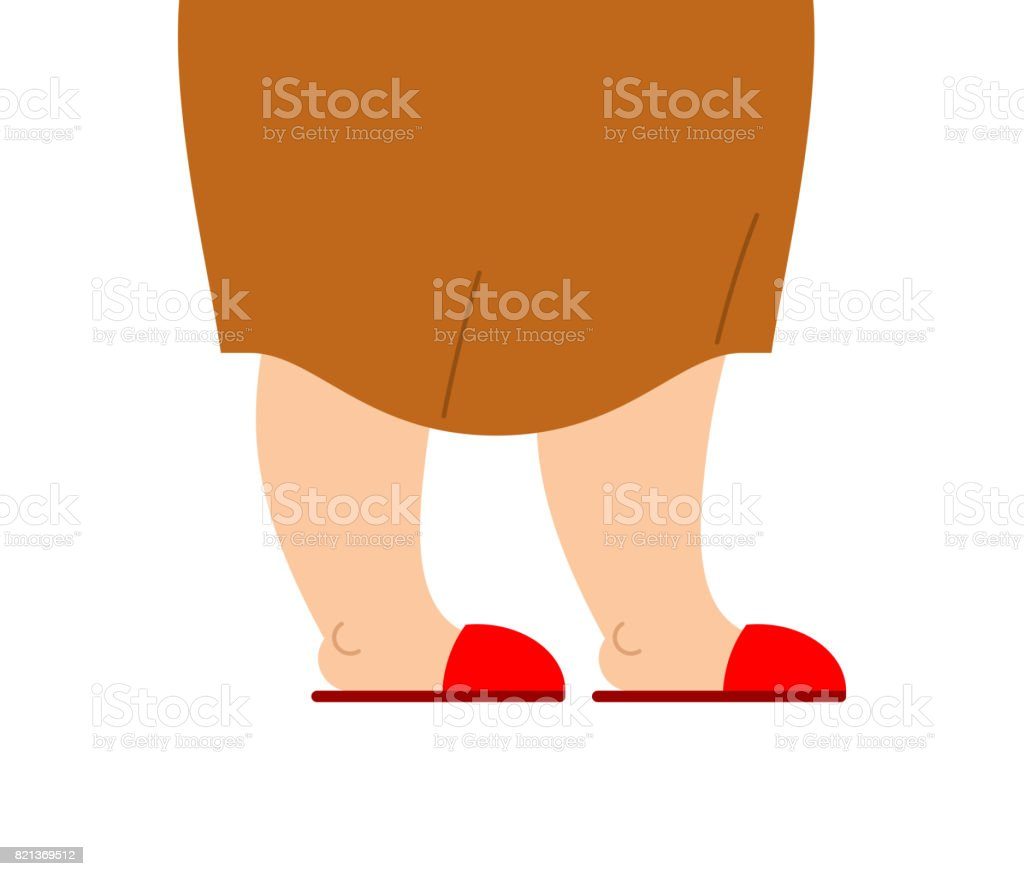 Grandmother Legs Are In Slippers Feet Of An Elderly Woman