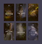 Graphic design of tags for denim clothing. Typographic composition on blurred background