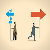 Graphic showing businessman holding blue and red arrow signs