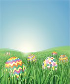 Grass Field with Easter Eggs. Vector Illustration. The eggs are rendered complete and grouped. Layered file.