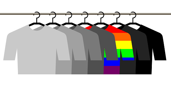 gray and rainbow shirts hanging on hangers