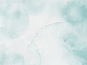 istock Gray Green Paper Texture Background. Border of hues of light green and gray paint splashing droplets. Watercolor strokes design element. Gray green colored hand painted abstract texture. 1171284890
