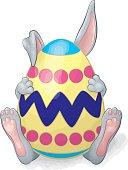 Gray Rabbit Hiding Behind Easter Egg