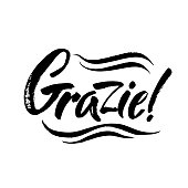 Grazie - thank you in Italian. Calligraphy inscription, black word on white background. Handwritten note
