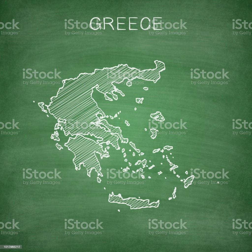Map of Greece drawn in chalk on a green chalkboard with chalk traces....