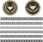 Two beautiful Greek plates with laurel wrath and various meanders in black and gold color.