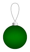 Green Christmas ball hanging on a thread.